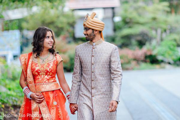 Indian couple walking before wedding ceremony