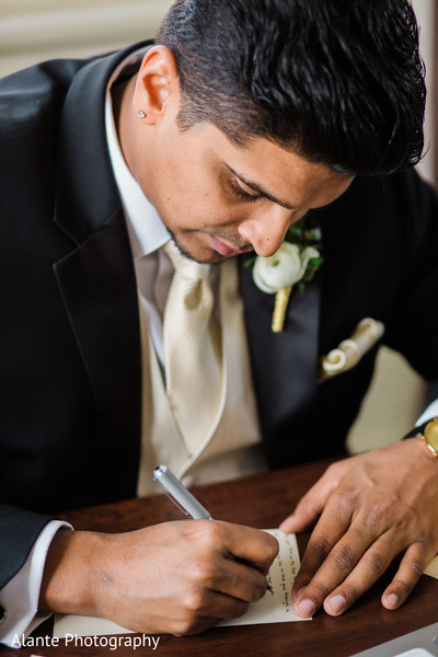 Groom writing a note