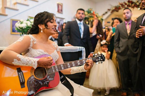 Maharani playing the guitar
