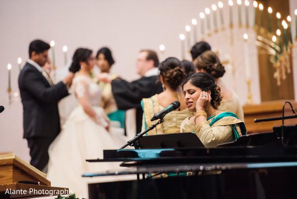 Bridesmaid singing during ceremony