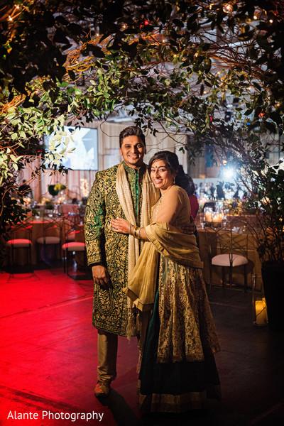 indian fusion wedding reception,green and gold sherwani,green and gold sari