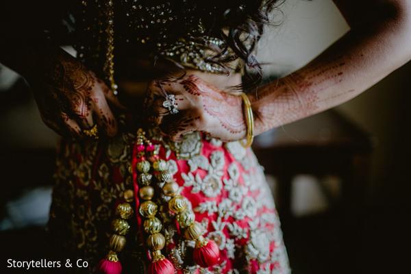 indian bride getting ready,indian bride,indian wedding mehndi
