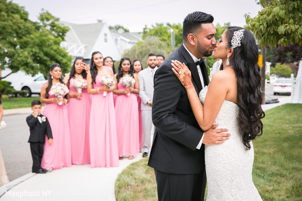 Indian couple kissing before wedding ceremony