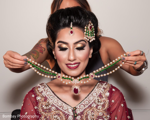 indian bride makeup,indian bride getting ready,indian bridal jewelry