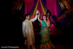 indian pre-wedding celebrations,sangeet decoration,stage,indian bride and groom