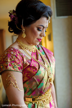 indian bridal hair and makeup,indian bride getting ready,ceremony fashion,south indian bride hairstyles
