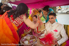 Indian bride and groom sangeet ceremony.