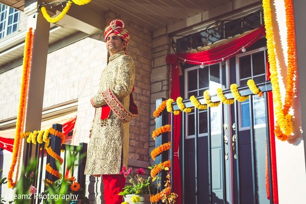 Indian groom in traditional wedding outfit