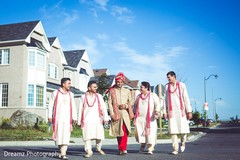 Indian groom walking with his groomsmen