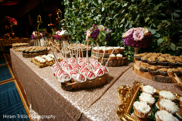 Amazing cakes and treats station. in Dallas, TX Indian Wedding by Hiram Trillo Art Photography