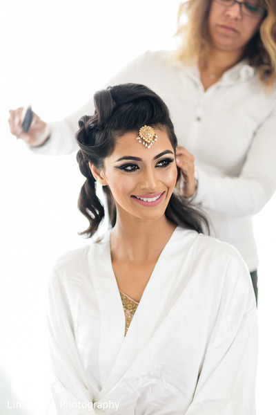 indian bride hair and makeup,indian bride getting ready,pre-wedding ceremony photography