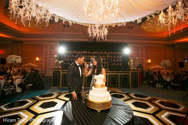 indian wedding cakes,cutting the cake