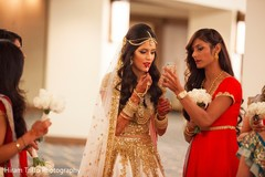 Maharani retouching her makeup