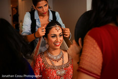 indian bride getting ready,indian bride,indian bridal jewelry,indian bridal hair and makeup