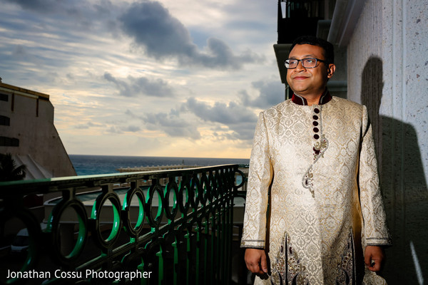 Indian groom in a cream sherwani. in Cancun, Mexico Indian Wedding by Jonathan Cossu Photographer