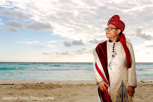 Indian groom sunset photography. in Cancun, Mexico Indian Wedding by Jonathan Cossu Photographer
